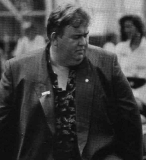 Just another day in John Candy's life, strolling down the street, under the gaze of the paparazzi.