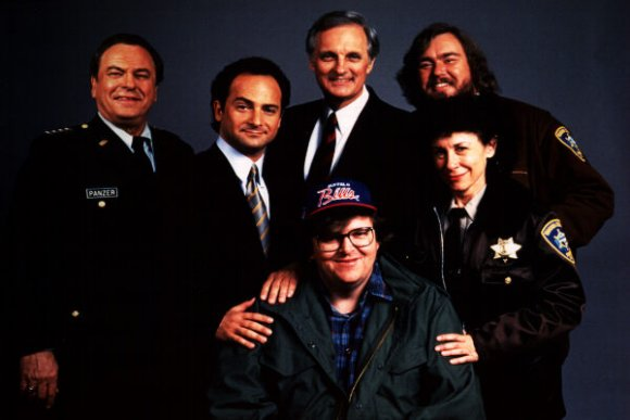 The main cast of Canadian Bacon and the director Michael Moore.