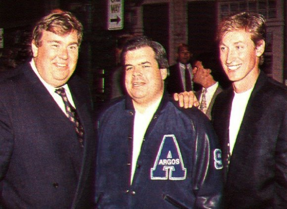 John Candy, Bruce McNall and Wayne Gretzky in happier days at the Toronto Argonauts.