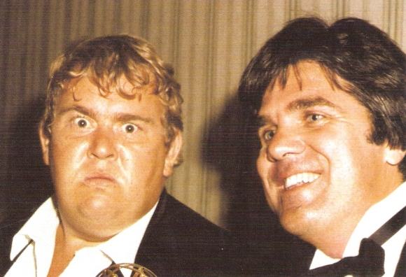 John Candy and Andrew Alexander enjoying their win at the Emmy Awards.