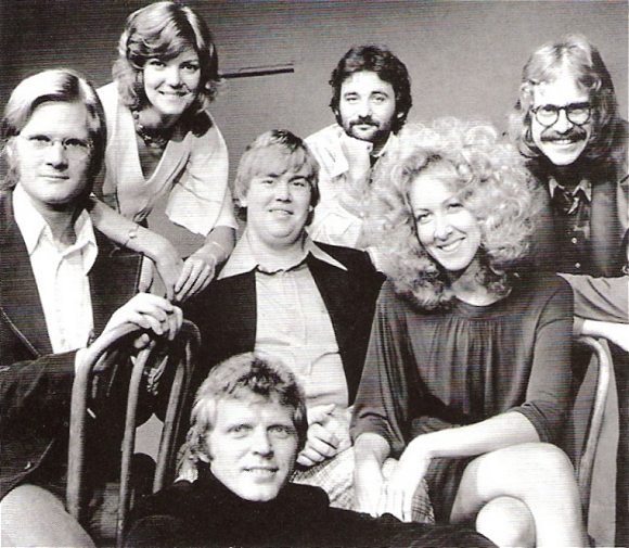 Some members of Second City, (clockwise from bottom): David Rasche, Jim Staahl, Ann Ryerson, John Candy, Bill Murray, Betty Thomas and Tino Insana.